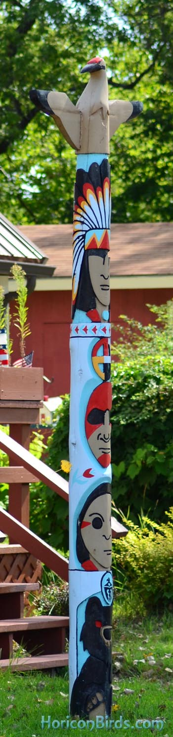 Whooping crane tops a totem pole on Menominee reservation, Wisconsin, photo by Pam Rotella